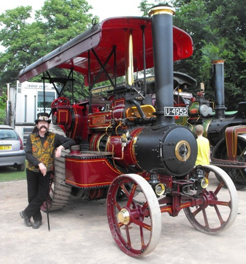 Captain Bellinger poses nonchalantly with traction engine